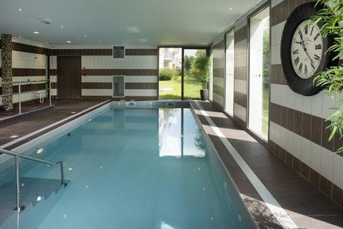 piscine - domitys - cheminée ronde