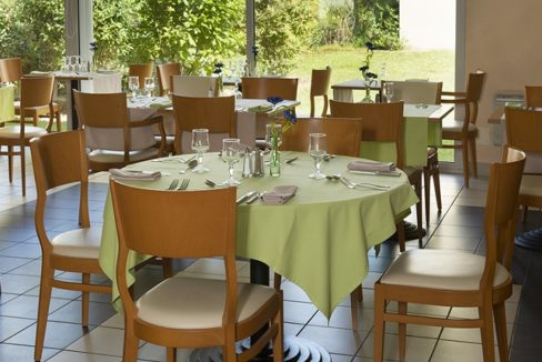 restaurant- domitys - cheminée ronde
